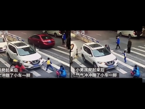 Chinese Boy Kicks The Car In This Viral Video