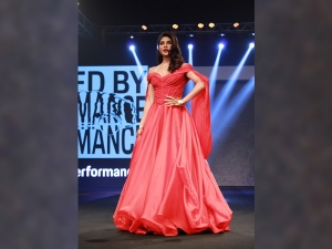 Jacqueline Fernandez In A Red Gown For The Porsche India Event