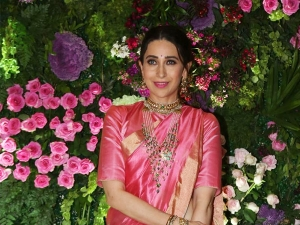 Karisma Kapoor In A Pink Silk Sari At Armaan Jain S Wedding