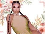 Kim Kardashian In Multi Tied Double Ponytails