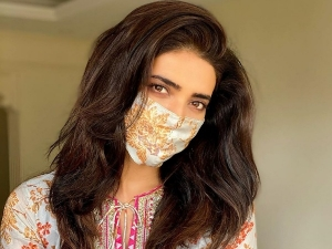 Sanju Actress Karishma Tanna In A Printed Kurti With Matching Mask