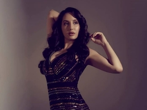 Bhuj Actress Nora Fatehi In A Glittering Black Dress For India S Best Dancer