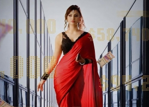 Urvashi Rautela In A Red And Black Saree In The Look Poster Of Black Rose