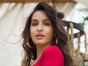 Bhuj Actress Nora Fatehi Rocks Her All Purple Look In Her Latest Covershoot