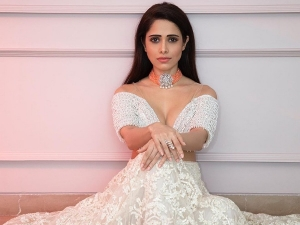 Nushrat Bharucha In White Crop Top And Skirt For Chhalaang Promotions