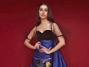 Actress Shraddha Kapoor In A Blue And Black Gown