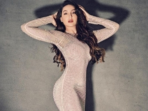 Nora Fatehi Welcomes New Year In A Stunning Peach Gown On Instagram