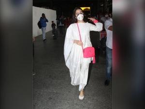 Sara Ali Khan Flaunts An Ivory Chikankari Suit And Pink Jewellery At Airport
