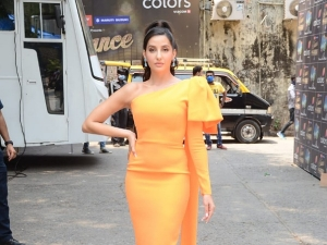 Nora Fatehi Spotted In An Orange Dress At The Colors Set