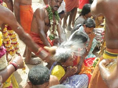 Priest Breaks Coconuts On People's Head